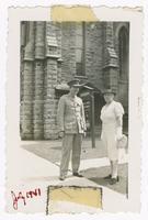1941-07, Stuart Ivison and woman beside Church